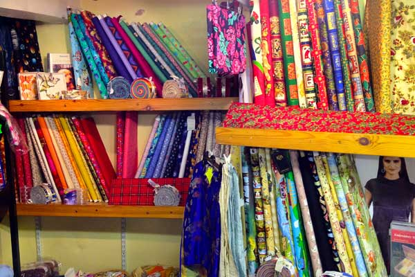 Dress materials, furnishing fabrics, wallpapers, paints, quilt-making supplies...